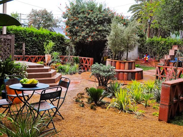 Rustic backyard patio this garden features a detailed for Garden fence features