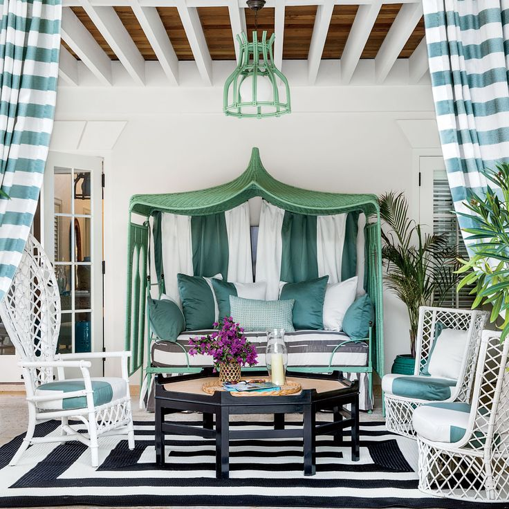 """""""Vintage pieces are especially organic and sculptural, and always appropriate in island homes. When I see things that grab me, like the sweet little rattan settees, long woven mirrors, and pendant light, I snap them up. I collect them, I paint some, I lea"""