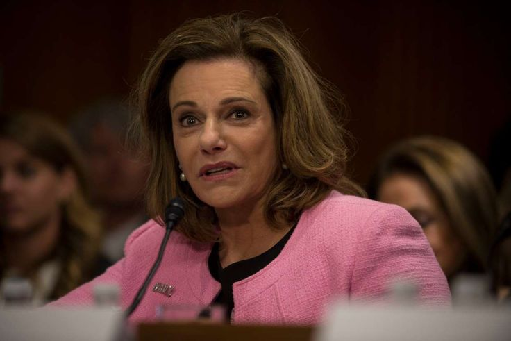 Kathleen Troia McFarland wearing a purple shirt: K. T. McFarland made clear in an email exchange that the Trump presidential transition team was intensely focused on relations with Russia.