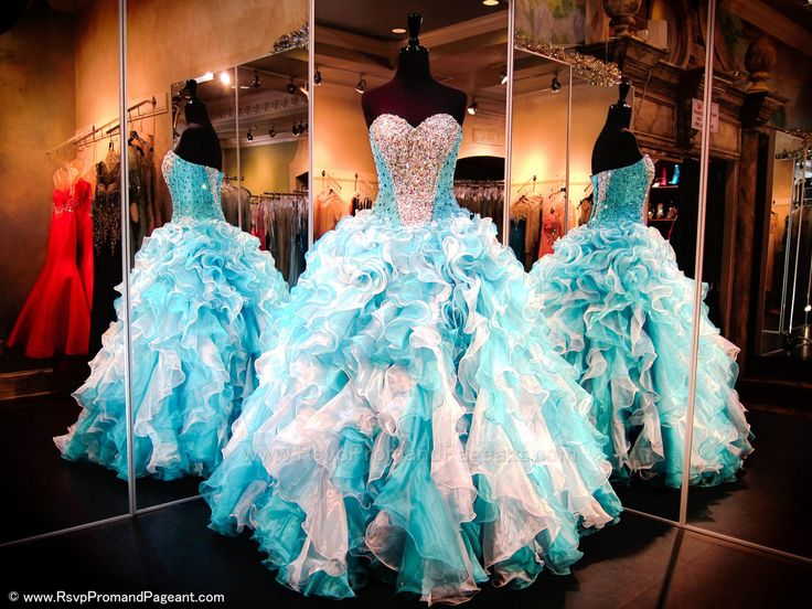 Dance the night away in this absolutely stunning Princess Gown! Sparkling crystals in heart shape adorn its sweetheart bodice. The lace-up back allows for easy up or downsizing and the full skirt features multi colored ruffles in turquoise and white. This amazing gown is perfect for quinceanera or pageant and it's at Rsvp Prom and Pageant, Atlanta, Georgia - 116EC0Q0152780