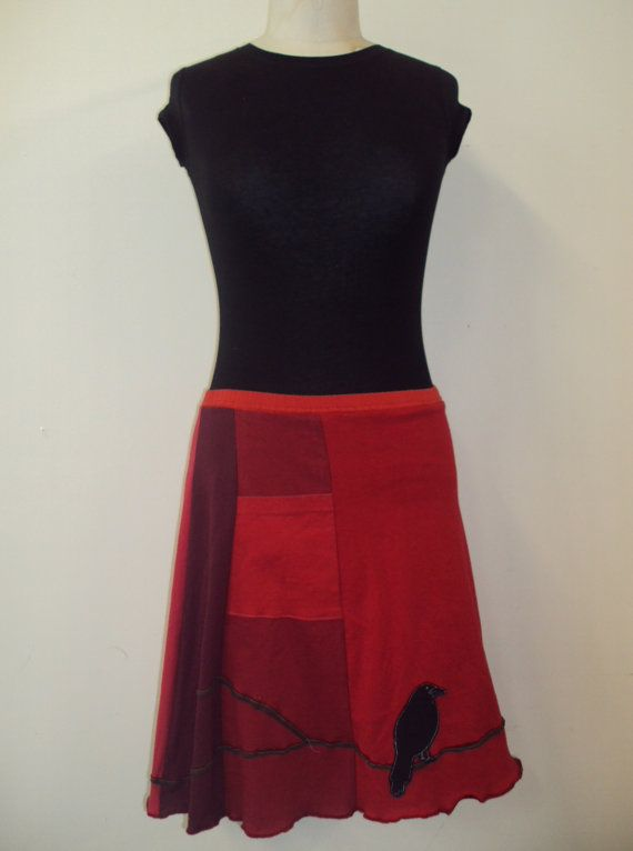 Upcycled, recycled, appliqué red t-shirt skirt with a branch and crow