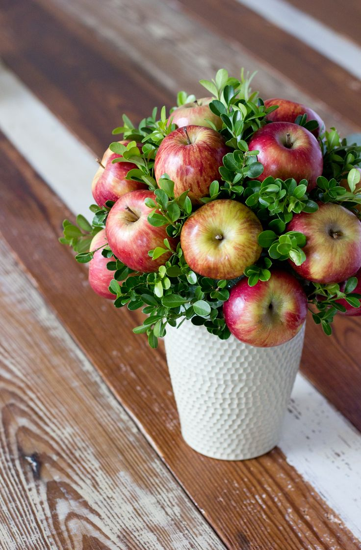 Large milk glass vase, apples, and maybe fall leaves or berries for table centerpieces (service auction)