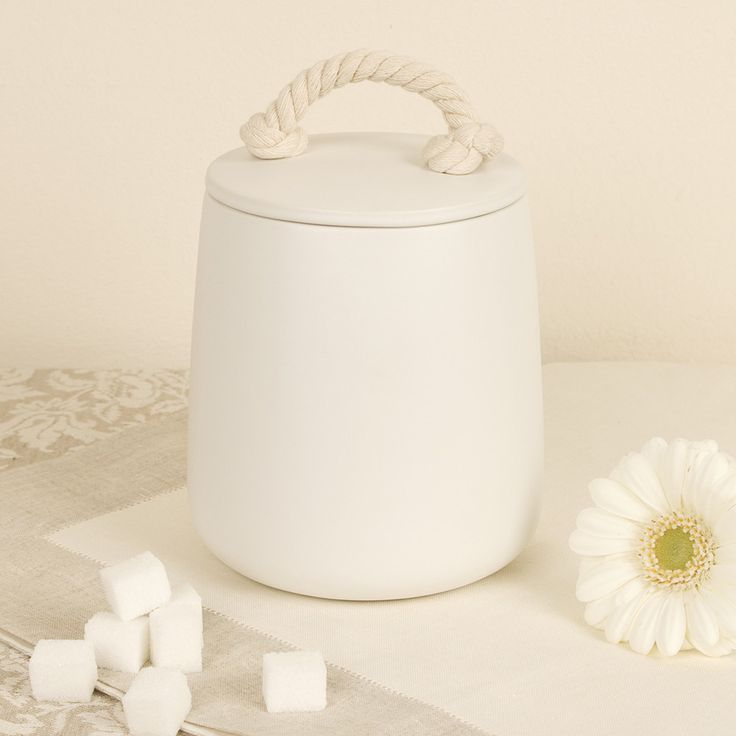 Contemporary barrel storage jar with lid. This natural stone ceramic storage jar with a jute rope handle to the lid. Complete with silicone seal therefore making this container air tight, can be used for storing foods in a Rustic kitchen, cotton buds and essentials in a nautical bathroom, or boiled sweets in the hallway. Made from ceramic, this generously sized storage container can be used in many different rooms in the home as well as complimenting many themes.