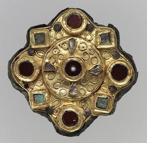 Disk Brooch, 650–725  Frankish; Found in Férebrianges or Petit-Troussy, northern France  Gold sheet with filigree and inlays of garnet, stone, glass, and pear