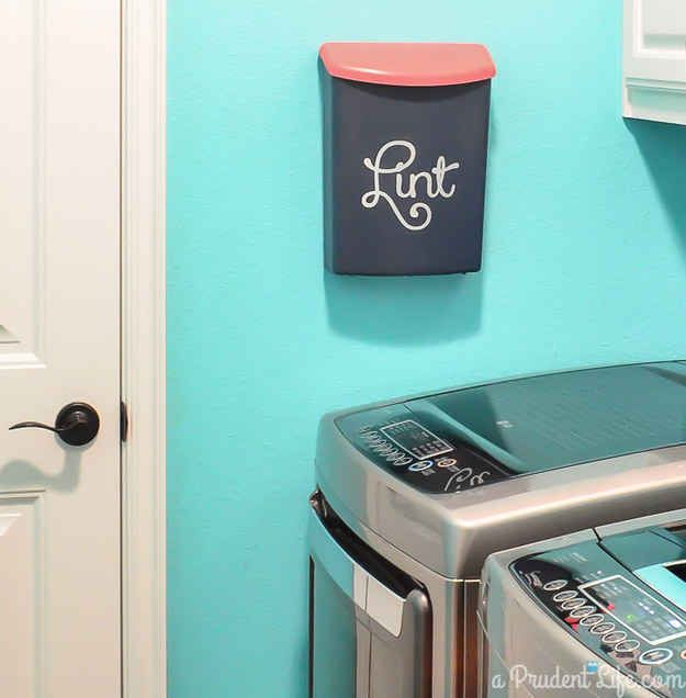 Turn an outdoor box into a mini trash can for lint. Perfect for those of us with little space and no garbage can! #thatgirlorganizes.guru