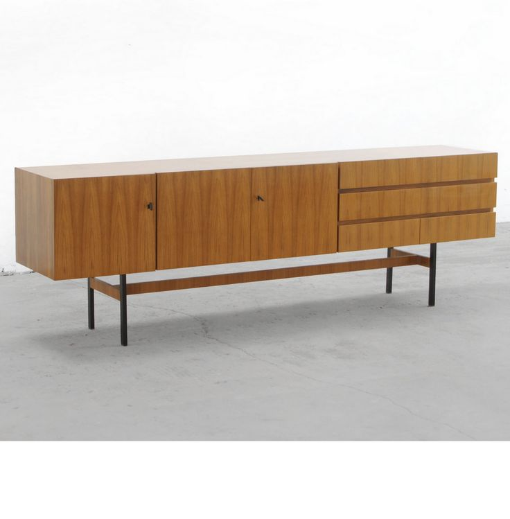 Anonymous; Walnut and Enameled Metal Sideboard by Musterring, 1960s.