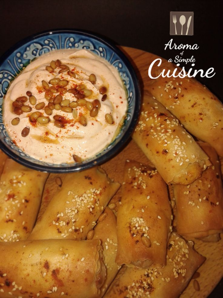 Αroma of a Simple Cuisine ~ Pastirma pies with feta cheese & sun dried tomatoes & sauce with greek yogurt & pine nuts