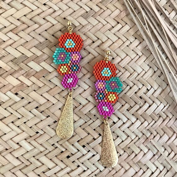 Orange and fuchsia Creole earrings with a golden cauri shell