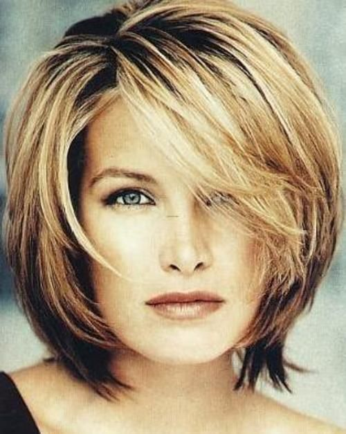 This hair cut appears to form a beautiful style around her face.Hair Colour:A lovely shade of light blonde ....with a beautiful touch of strawberry ....blonde highlights.     Digging this style for someday in the future when I get either sick of my long hair or too mature for long stringy hair