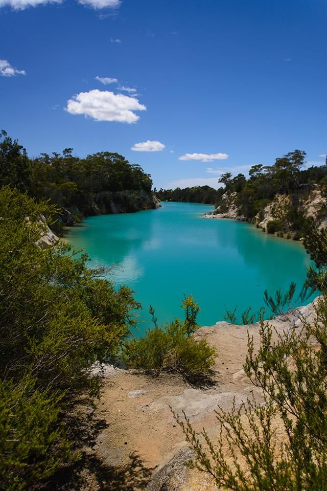 One of the interesting side effects of the Tin mine at Derby is Little Blue Lake. The Lake was formed from the waters used in sluicing the ore and reflects a vivid aqua blue from the minerals in its base. #littlebluelake #tasmania #discovertasmania Image Credit: Passionfruit Photography