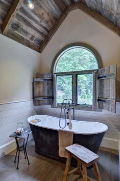 beautiful bathroom ~ love the exposed wood ceiling, plank wood on the walls & the old-fashioned style tub
