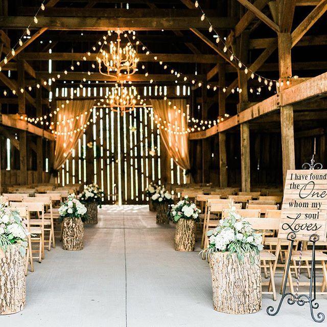 Refined Rustic Barn Wedding Ceremony With Tree Stumps Along Aisle Barnwedding Refinedrustic Weddi Barn Ceremony Winter Barn Weddings Country Barn Weddings
