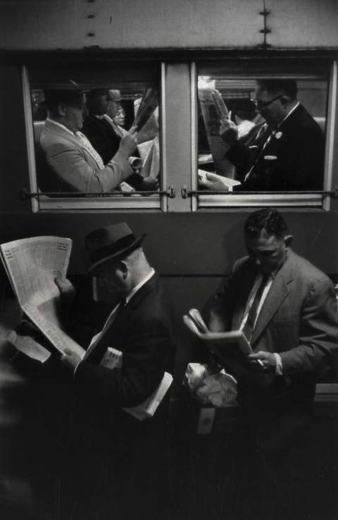 I think it's interesting how each man is so enveloped in the paper that they seem to be unaware of their surroundings. #U4APSA