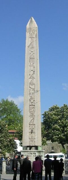 Obelisk of Thutmosis III, at the base showing Theodosius the Great (Roman Emperor, 379-395). The obelisk is now located in Istanbul, Turkey Hippodrome of Constantinople. In 390, Theodosius had the obelisk cut into three pieces and brought to Constantinople. Only the top part survives, and it stands today where he placed it, on a marble pedestal.
