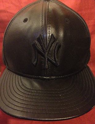 New York Yankees Leather Baseball Cap  Mint Condition used for a Display  NY Yankees New with Stickers  Baseball Hat   BLACK LEATHER design   59 Fifty Size: 7 1/2Embroidered Letters and Logo's  Genuine MLB Merchandise   THIS LEATHER HAT COMES WITH NATURAL SCRATCHES, WRINKLES, STAINS, AND OTHER IMPERFECTIONS