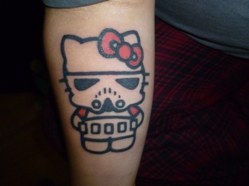 Tattoo<3 This is my first tattoo that I got done at a tattoo party for my moms birthday, and I adore it. I wanted Hello Kitty as a stormtrooper because it shows my girly side, and my nerdy side. I got a lot of crap from people?at the party?about it, but screw them, I think its a good way to represent the real me and I also think its beautiful! Tattoo~