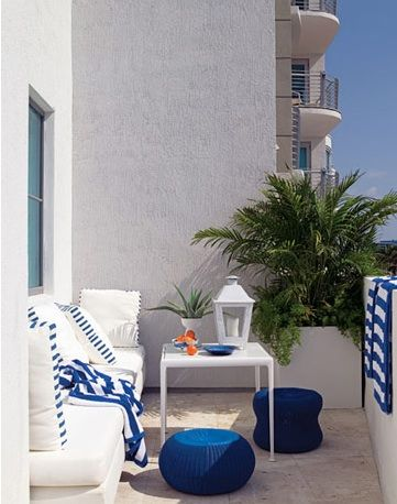 House Beautiful - decks/patios - deck, sofa, table, lantern, blue, indigo blue, indigo blue accents, high rise deck, outdoor sofa,  Great ou...