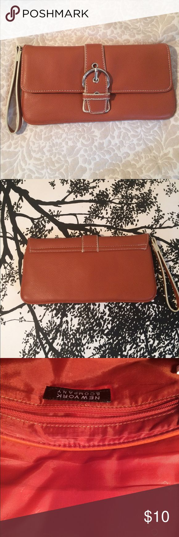 New York & Company like new dark orange clutch Perfect for fall, this dark orange clutch from New York & Company has never been used! Paired with denim, gray, white or black it provides that pop of color every outfit needs! 10 in long x 5 in Bags Clutches & Wristlets