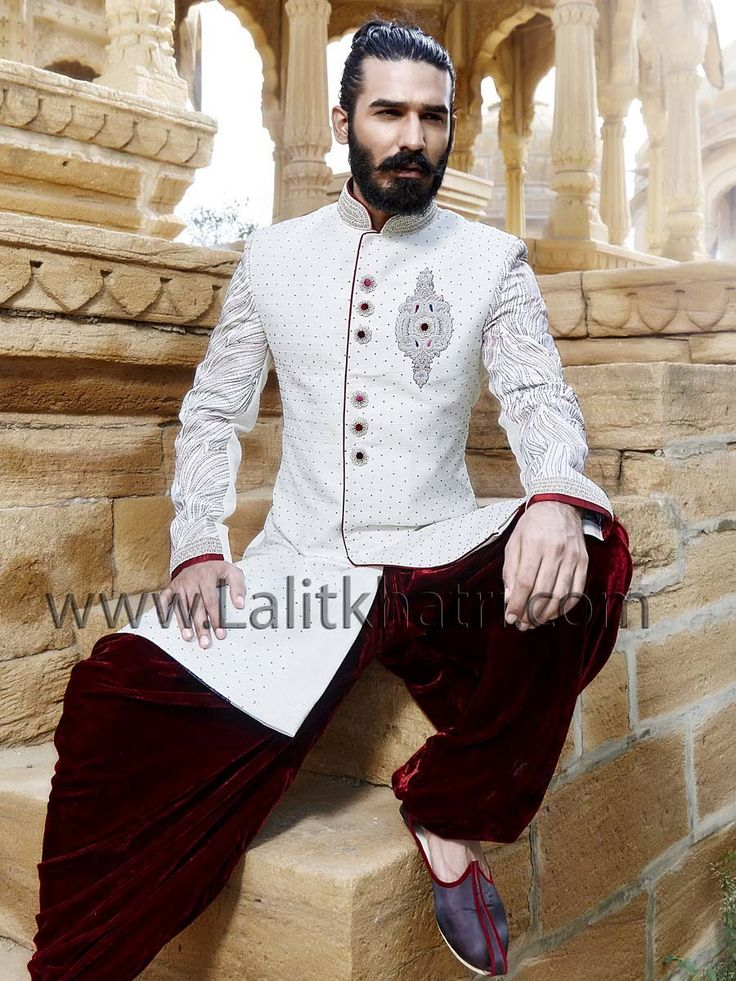 Miraculous white color raw silk indo western with glittering diamantes work collar and scattered stones. Item code: SIJ6802 http://www.lalitkhatri.com/label/what-s-new/men.html