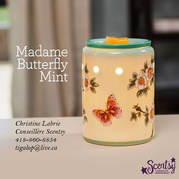Réchaud Scentsy de Qualité supérieure Madame Butterfly Yellow   La splendeur du printemps prend vie avec des papillons et des fleurs inspirés de la soie chinoise. Porcelaine légèrement brillante.