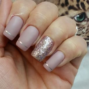 Beige matte nails with a thin gold stripe and an accent gold glitter nail. Gorgeous!: