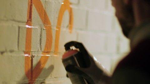 Street Art Artist, Spray (Aerosol), Graffiti Artist, Sprayer (Graffiti), Aerosol Can, Embassy, Wall (Object), Urban Culture, Western Script, Spraying (Process), Urban Life, Wall (Architecture), Street Scene, Lifestyle (Concept), 1 (Quantity), Building (Edifice), Man (Human), Adult, People,