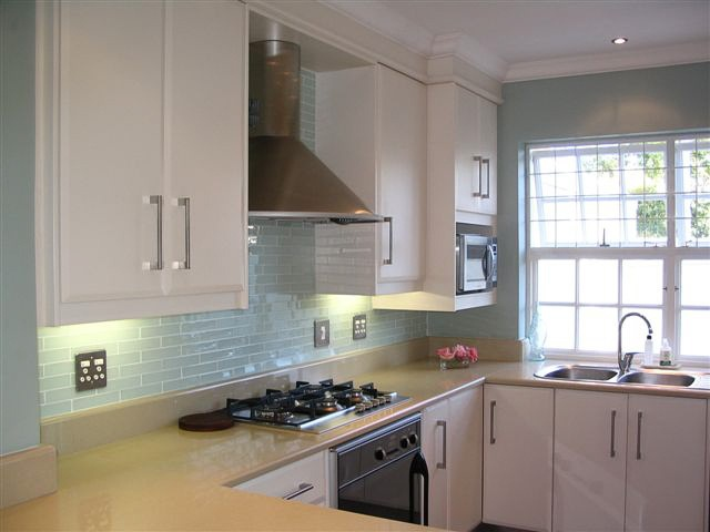 Stunning duck egg green tile splashback kitchen for Duck egg blue kitchen island