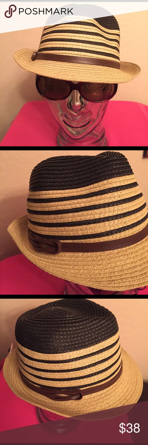 🆕 Calvin Klein Straw Fedora Authentic Calvin Klein Straw Fedora. Natural Tan with Black Crown & Bands. Faux Brown Leather Strap that Wraps, then Loops on the Right Side. Adjustable Drawstring is inside Black & White Lining; see Last Pic. 87% Paper/13% Polyester. Brand New. Excellent Condition. No Trades. Calvin Klein Accessories Hats