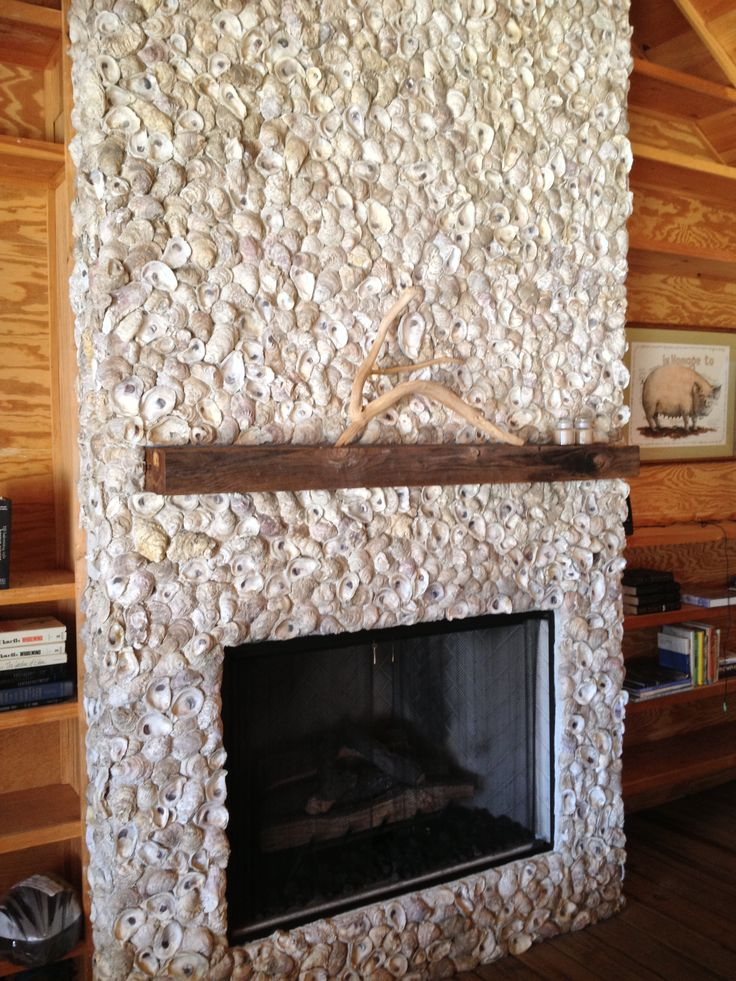 Fireplace wall made with oyster shells!