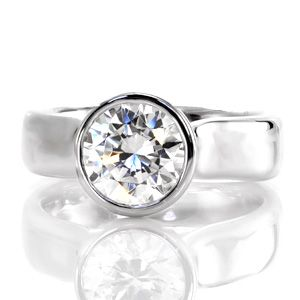 Twilight - Twilight is a sophisticated engagement ring. The thick contemporary bezel contours the round outline of the 2.0 carat center stone. Set far above the mounting, the heightened cathedral displays the acclaimed profile of a round brilliant. The polished 14k white gold glistens from every angle.