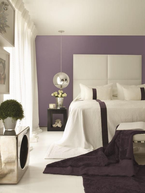 Wall panels and oversized bedspread. Interior by Kelly Hoppen
