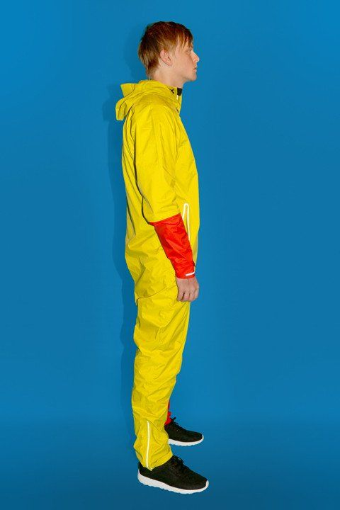 RAYNSIE DIP YELLOW RED RAYNSIE is a weatherproof coverall, optimized for city riders. Premium performance raingear, designed to welcome any meteorological challenge with open arms. It's waterproof, windproof, breathable and packable.
