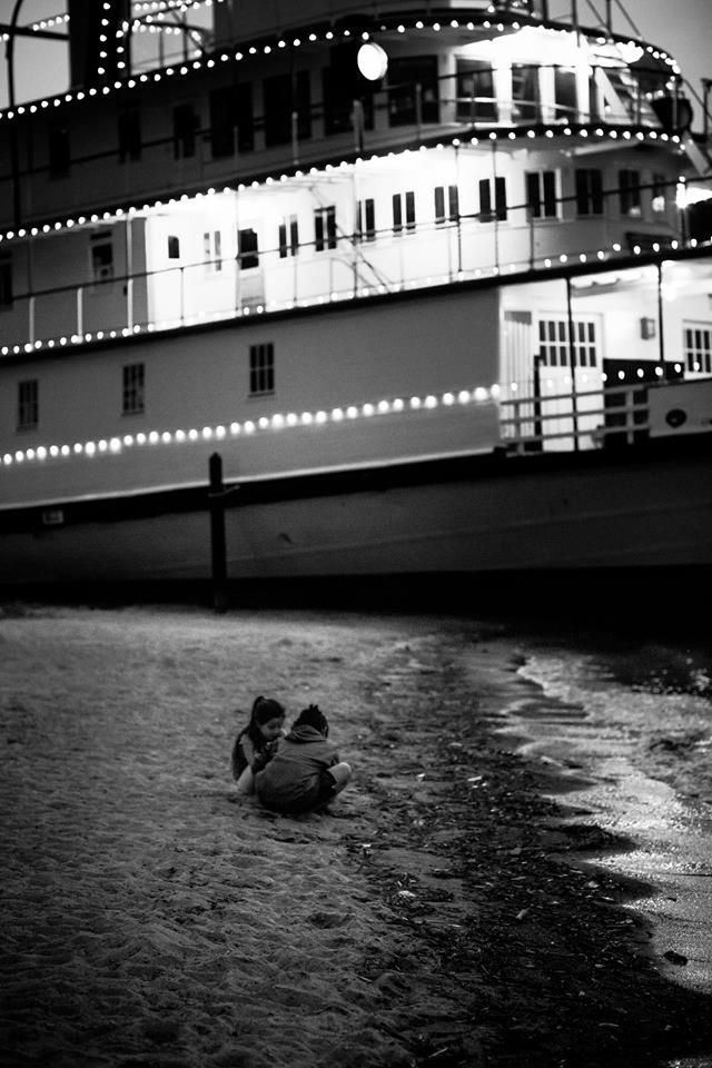 David Secor Photography - SS Sicamous at dusk. Children on the beach. Ship at night.