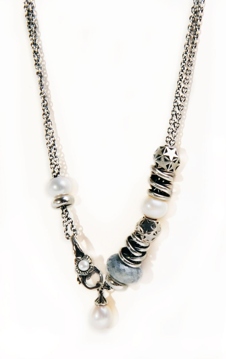 Add a pearl necklace to bring out sophistication to your denim look. #OrderTrollbeads #Trollbeads #TrollbeadsNecklace