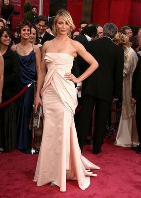 Boyish figures look for what Cameron is wearing.  She created an hourglass shape with the draping of the dress.