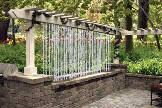 Quick & Easy Waterfall Wall - Divider This pergola, showcased at the Notre Dame Home and Garden Show, features a unique water wall designed by Scott. It has a water line that runs all the way along the top beam to drop the water back into the EPDM lined trough. A small pump then runs the water back up the post at the other end.
