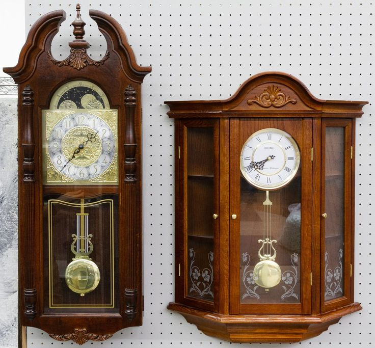 Lot 758: Seiko and Howard Miller Wall Clocks; Seiko battery operated Westminister-Whittington and Howard Miller Dual Chime; both having pendulums
