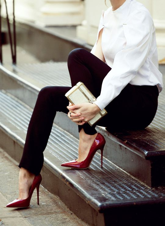 Very structured & architectural white button down shirt, black pants & Oxblood heels