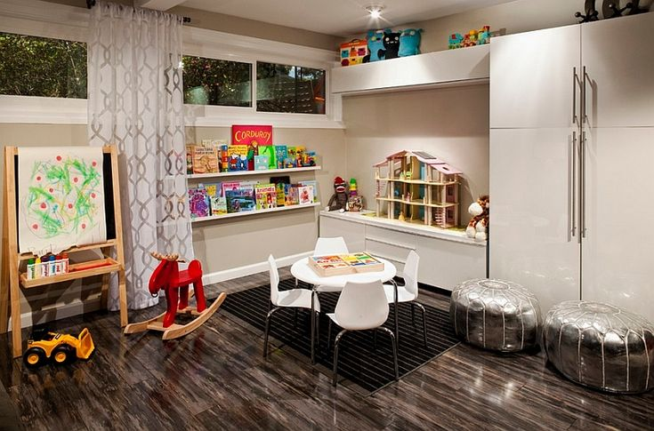 Like the idea of the low shelving unit where kids can access top, and high cabinets to hide the rest