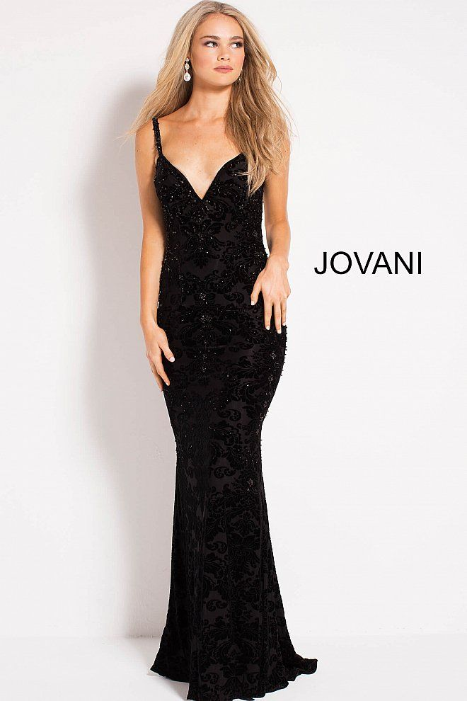 585082411f01 Floor length form fitting embellished velvet burn out prom dress features  spaghetti straps bodice with plunging v neck and low v back.