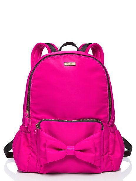 there's no more essential school accessory than a rugged backpack with a personality aplenty. nylon makes it strong; the bow-topped pocket gives it sass.
