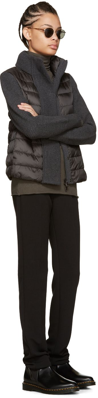 Long sleeve quilted down jacket in grey. Knit panelling throughout. Stand collar. Two-way zip closure at front concealed by press-stud placket. Seam pockets at waist. Logo appliqué at upper sleeve. Tonal stitching. Fill: 90% goose down, 10% feathers.