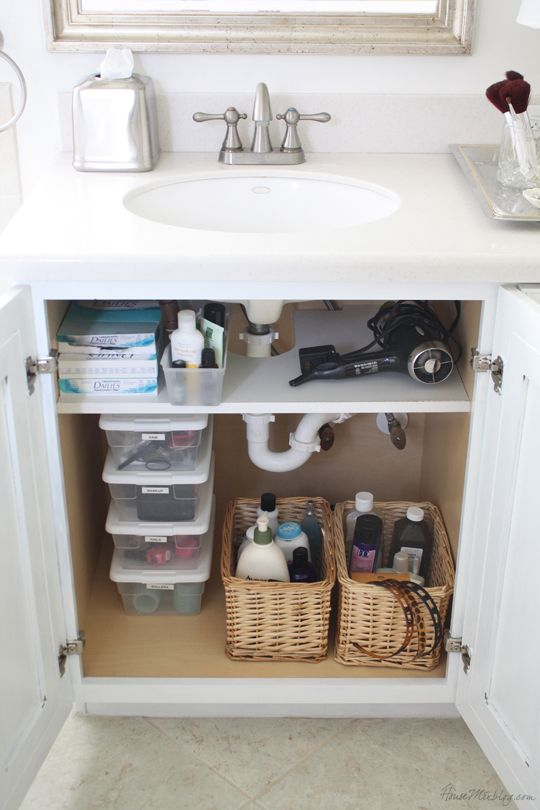 good idea to add a shelf (that has cut out for pipes) for storage under a bathroom sink