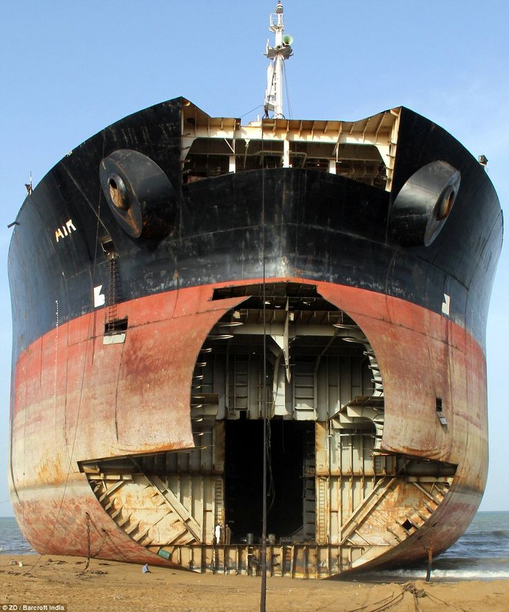 The bow of a giant tanker which has been partially dismantled sits on the beach at the Gadani ship-breaking yard near Karachi
