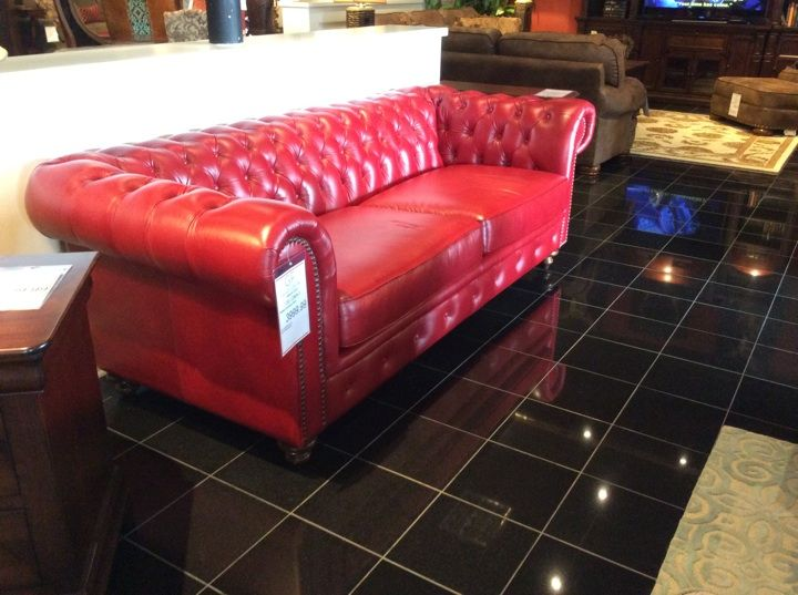 deep diamond tufting on the back and arms of this stunning american made real leather sofa is echoed along the front frame