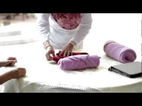 I do this with all my towels in the motorhome now! Easy! Wow! Nice! How to fold towels for easy storage. - YouTube