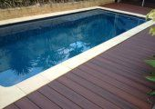Swimming pool decking is elegant, classic and has a range of benefits including:  *Soft under foot *Cool in summer *Water doesn't pool on surface *Less slippery than concrete* Weeds wont grow between boards *It's natural