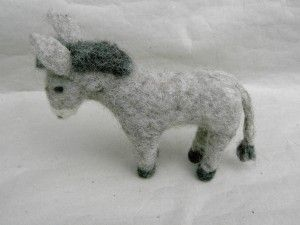 Tiere an der Krippe: Esel