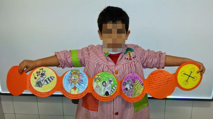 Manualidades cuentos infantiles- Por un beso y un achuchón te cuento un cuento en un botón!!! Los niños han ilustrado las viñetas del cuento que tiene forma de botón.