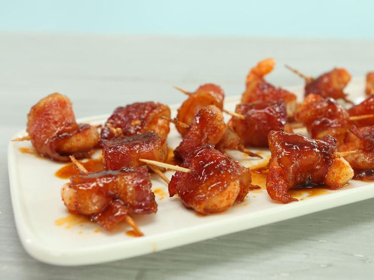 Spicy-Sweet Bacon Wrapped Shrimp | In under 30 minutes, you can dress crispy bacon wrapped shrimp in brown sugar, paprika, and smoked red pepper for a dynamically delicious...